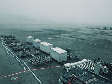 Example of commercial tarmac driveways: a large car park in a foggy industrial estate.